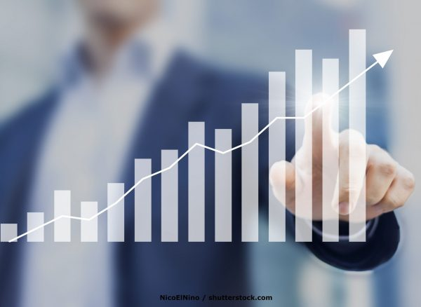 Business,Success,With,Growing,,Rising,Charts,And,Businessman,In,Background